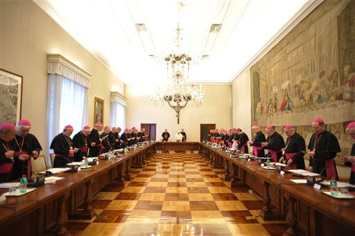 In this picture made available by the Vatican newspaper Osservatore Romano, Pope Benedict XVI, background center, meets with Irish Bishops at the Vatican, Monday, Feb. 15, 2010.  (AP Photo/Osservatore Romano, HO)