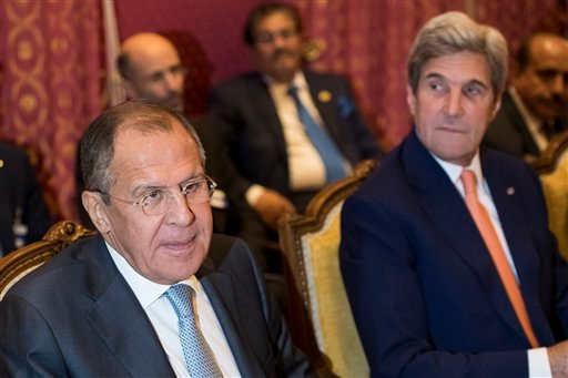 (Jean-Christophe Bott/Pool Photo via AP). Russian Foreign Minister Sergey Lavrov, left, and U.S. Secretary of State John Kerry, right, attend a bilateral meeting where they discussed the crisis in Syria, in Lausanne, Switzerland, Saturday, Oct. 15, 2...