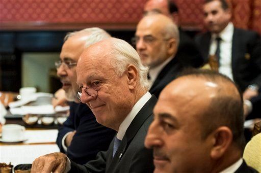 (Jean-Christophe Bott/Pool Photo via AP). Iranian Foreign Minister Mohammad Javad Zarif, Staffan de Mistura, UN Special Envoy of the Secretary-General for Syria, and Turkish Foreign Affairs Minister Mevlut Cavusoglu, from left, attend a meeting where...
