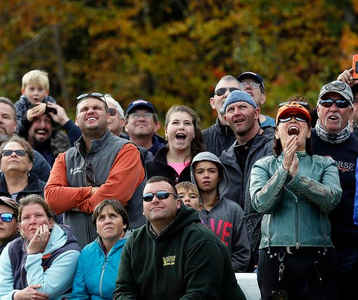 """(AP Photo/Jim Cole). In this Saturday, Oct. 15, 2016 photo, spectators watch pumpkins get launched jingo the sky during the """"Extreme Chunkin"""" contest at New Hampshire Motor Speedway in Loudon, N.H."""
