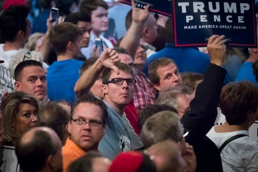 (AP Photo/John Minchillo). Supporters of Republican presidential candidate Donald Trump react towards the media during a campaign rally, Thursday, Oct. 13, 2016, in Cincinnati.