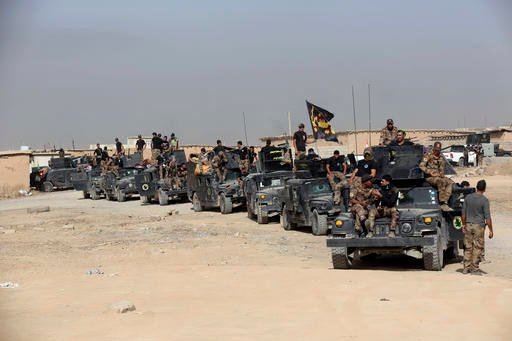 (AP Photo/Khalid Mohammed, File). File -- In this Saturday, Oct. 15, 2016 file photo, Iraq's elite counterterrorism forces gather ahead of an operation to re-take the Islamic State-held City of Mosul, outside Irbil, Iraq. Iraqi forces appear poised to ...