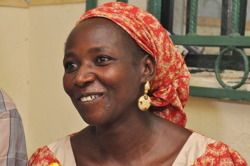 ( AP Photo/Gbemiga Olamikan). Hawa Abana, mother of Blessing Abana, one among of the freed twenty-one Chibok schoolgirls smiles during an interview in Nasarawa, Nigeria, Saturday, Oct. 15, 2016. Conflicting reports emerged Friday about whether the firs...