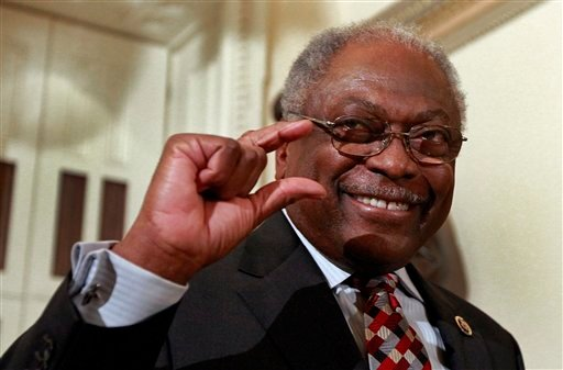 Rep. James Clyburn, D-S.C., guestures as he walks through statuary hall as the House prepares to vote on health care reform in the U.S. Capitol in Washington, Sunday, March 21, 2010. (AP Photo/Alex Brandon)