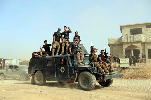 (AP Photo/Khalid Mohammed, File). FILE -- In this Saturday, Oct. 15, 2016, file photo, Iraq's elite counterterrorism forces gather ahead of an operation to re-take the Islamic State-held City of Mosul, outside Irbil, Iraq. Iraqi forces appear poised to...