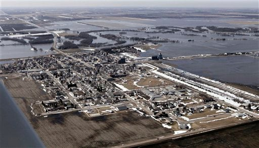 The city of Perley, N.D. is surrounded by flood waters from the swollen Red River, Sunday, March 21, 2010, north of Fargo, N.D.