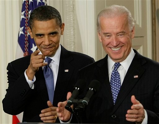 President Barack Obama and Vice President Joe Biden react to cheers as they arrive in the East Room of the White House in Washington for the signing ceremony for the health care bill. (AP Photo/J. Scott Applewhite)