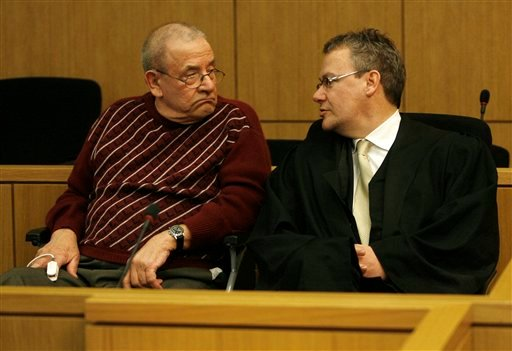 Former member of Adolf Hitler's Waffen SS, Heinrich Boere, left, sits in his wheelchair next to his lawyer Gordon Christiansen during his trial in the courtroom of the court in Aachen, Germany,Tuesday, March 23, 2010.