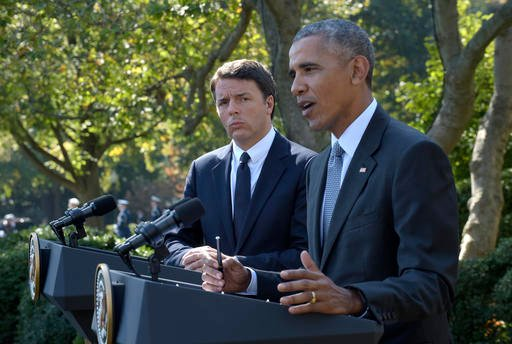Italian Prime Minister Matteo Renzi listens as President Barack Obama listens during their joint news conference in the Rose Garden of the White House in Washington, Tuesday, Oct. 18, 2016.