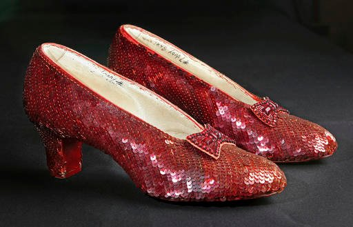 """(AP Photo/Reed Saxon, File). File- This Nov. 9, 2001, file photo shows the sequin-covered ruby slippers worn by Judy Garland in """"The Wizard of Oz"""" at the offices of Profiles in History in Calabasas, Calif. Smithsonian Museum officials started a Kickst..."""