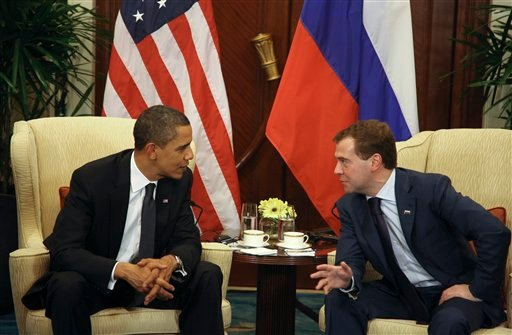 In this Nov. 15, 2009, file photo U.S. President Barack Obama speaks with his Russian counterpart Dmitry Medvedev.
