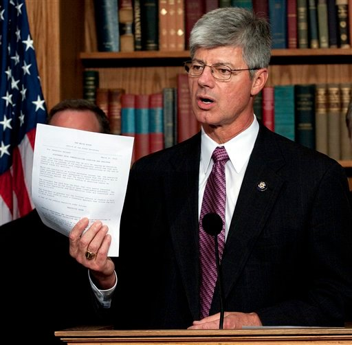 Rep. Bart Stupak, D-Mich., announces he will vote to pass the health care reform bill after President Obama agreed to sign an executive order reaffirming the ban on the use of federal funds to provide abortions. (AP Photo/Harry Hamburg)
