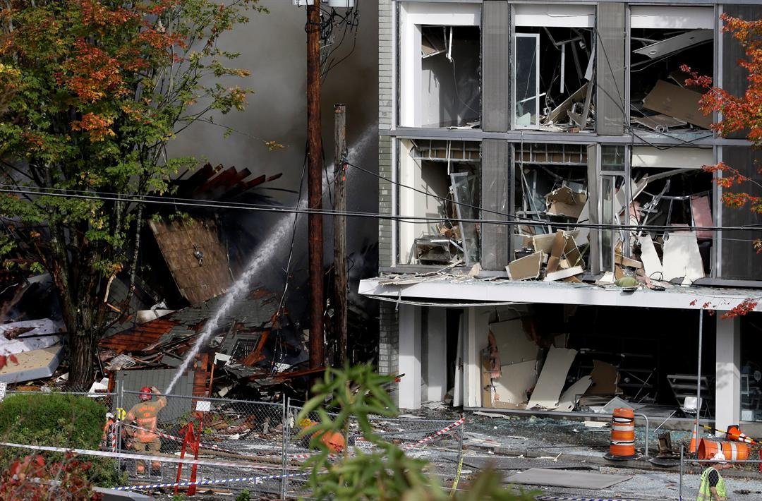 One building in the popular shopping district was reduced to rubble and the exterior of one side of another building had been ripped off, its windows blown out. (AP Photo/Don Ryan)