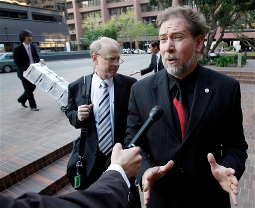 Attorney Tim Howard talks to a reporter as he enters the federal courthouse for a hearing on whether dozens of cases will be consolidated before a single judge in San Diego, Calif., Thursday, March 25, 2010.