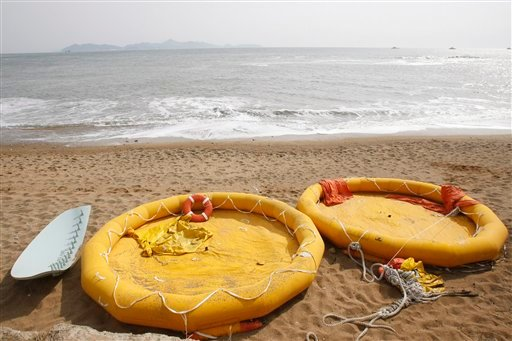 Life boats, believed to be used by sailors of the sunken South Korean naval ship Cheonan, are seen on a beach. (AP Photo/Ahn Young-joon)
