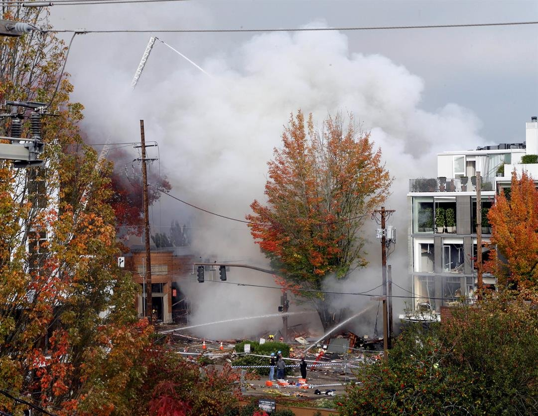 Smoke rises as firefighters battle a blaze after a gas explosion in Portland, Ore., Wednesday, Oct. 19, 2016. A powerful natural gas explosion that neighbors said felt like an earthquake rocked the busy injuring two firefighters and two civilians. One bui