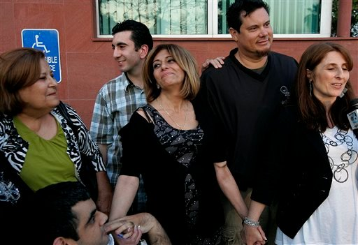From left, Lilya, Andrew, Muna Salomi, Johnand Vivian Tilley celebrate upon hearing Issa Salouma was freed from kidnappers in Iraq, during an interview in San Diego on Saturday, March 27, 2010.