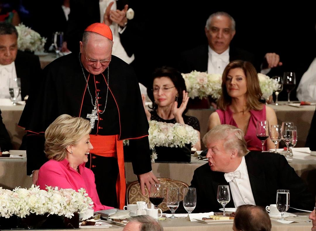Democratic presidential candidate Hillary Clinton, left, speaks to Republican presidential candidate Donald Trump, right, after her remarks at the 71st Annual Alfred E. Smith Memorial Foundation Dinner Thursday, Oct. 20, 2016, in New York. (AP Photo/Frank