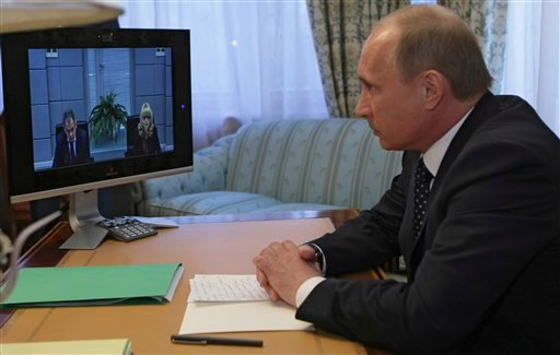 Russian Prime Minister Vladimir Putin chairs a meeting on the double suicide bombings on Moscow subway held in the Siberian city of Krasnoyarsk, Monday, March 29, 2010. (AP Photo/RIA-Novosti, Alexei Nikolsky, Pool))