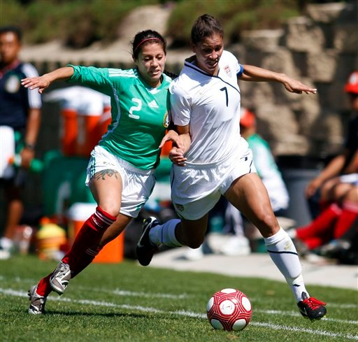 Mexico's Leticia Villalpando, left, and USA's Shannon Boxx, right, battle over a loose ball during their soccer match Sunday, March. 28, 2010, in San Diego. The U.S. won 3-0. (AP Photo/Chris Park)