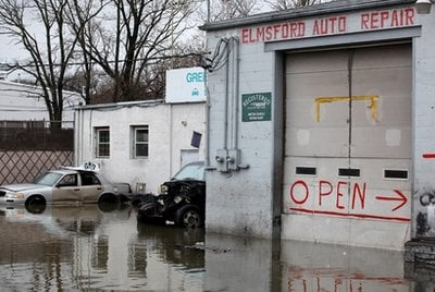 Businesses in a low-lying area of Greenburgh, N.Y. are surrounded by water Sunday, March 14, 2010 after storms that ripped through sections of the Northeast. (AP Photo/Craig Ruttle)