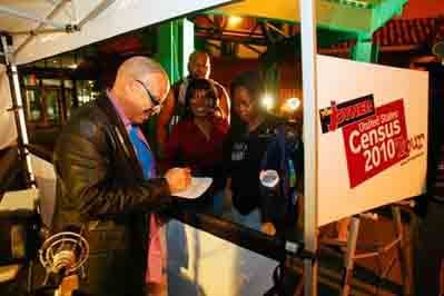 Radio host Tom Joyner, left, of the nationally syndicated Tom Joyner Morning Show signs autographs as he hosts a show urging people to fill out the 2010 Census Wednesday, March 31, 2010, outside the Greenspoint Mall in Houston, Texas.