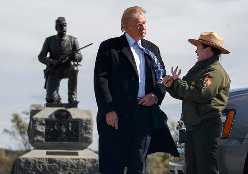 (AP Photo/ Evan Vucci). Interpretive park ranger Caitlin Kostic speaks to Republican presidential candidate Donald Trump as she gives him a tour at Gettysburg National Military Park Saturday, Oct. 22, 2016, in Gettysburg, Pa.