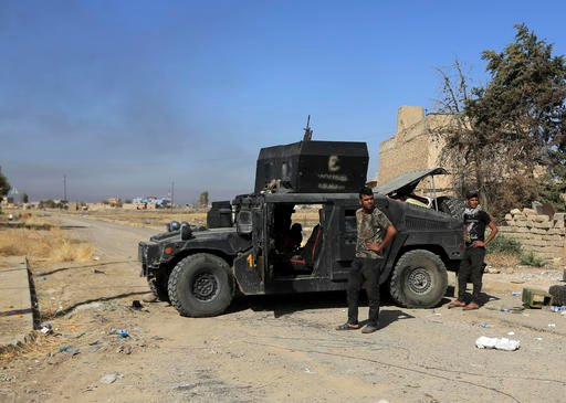 (AP Photo/Khalid Mohammed). Iraq's elite counterterrorism forces are deployed in the town of Bartella, Iraq, Saturday, Oct. 22, 2016. Iraqi forces retook Bartella, around 15 kilometers (9 miles) east of Mosul, earlier this week, but are still facing po...