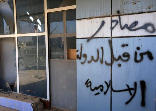 "(AP Photo/Khalid Mohammed). Arabic that reads ""confiscated by Islamic State"" is written on a restaurant in the town of Bartella, Iraq, Saturday, Oct. 22, 2016. Iraqi forces retook Bartella, around 15 kilometers (9 miles) east of Mosul, earlier this wee..."