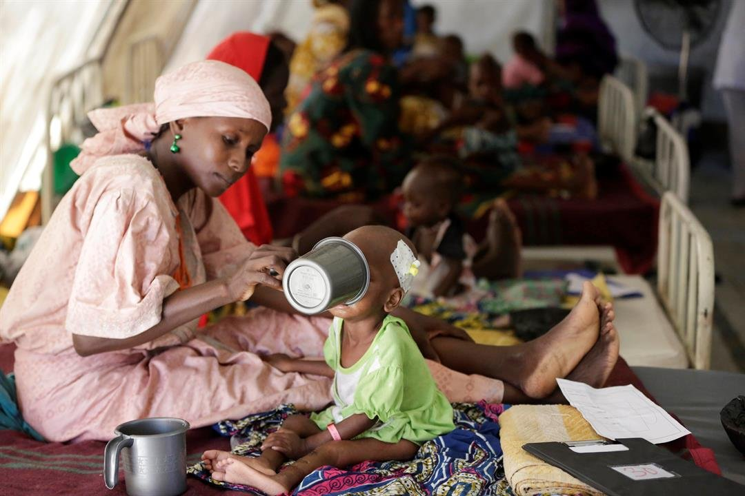 In this Monday Aug. 29, 2016 file photo, a mother feeds her malnourished child at a feeding centre run by Doctors Without Borders in Maiduguri Nigeria. During its seven-year uprising, Boko Haram extremists have killed more than 20,000 people and displaced