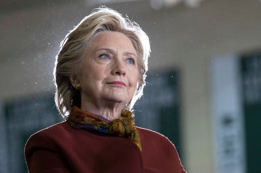 (AP Photo/Mary Altaffer). Democratic presidential candidate Hillary Clinton listens as vice presidential candidate Sen. Tim Kaine, D-Va. speaks during a campaign event at the Taylor Allderdice High School, Saturday, Oct. 22, 2016, in Pittsburgh, Pa.