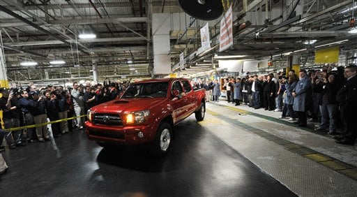 Employees at the NUMMI plant get a look the last Toyota Tacoma truck to come off the line in this photo provided by NUMMI on Friday, March 26, 2010 in Fremont, Calif.