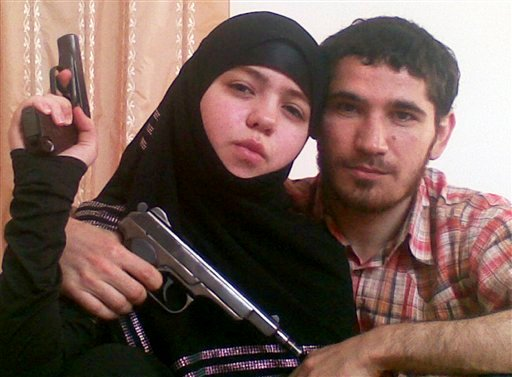This undated picture provided Friday, April 2, 2010 by the Russian news agency NewsTeam, is claimed by the Russian Kommersant newspaper to show Dzhennet Abdurakhmanova, left, and her husband Islamist rebel Umalat Magomedov. (AP Photo/NewsTeam)