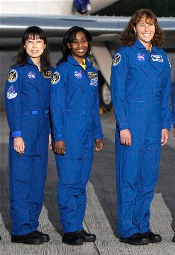 From left, Japan Aerospace Exploration Agency astronaut Naoko Yamazaki, mission specialists Stephanie Wilson and Dorothy Metcalf-Lindenburger