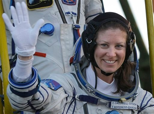 U.S. astronaut Tracy Caldwell Dyson gestures prior to the launch of a Soyuz-FG rocket at the Russian leased Baikonur Cosmodrome, Kazakhstan, Friday, April 2, 2010. (AP Photo/Misha Japaridze)