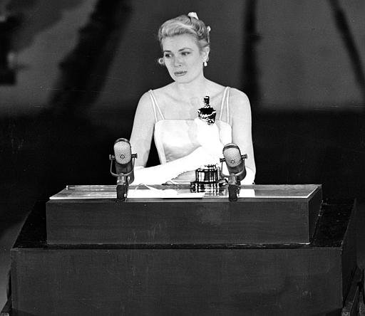 """Grace Kelly accepts the Oscar for Best Actress for her role in """"The Country Girl,"""" at the Academy Awards, March 30, 1955."""