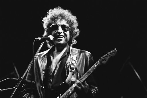 American singer Bob Dylan smiles as he performs during his show on Tuesday, June 24, 1981 at the Colombes Olympic stadium, West of Paris, France in front of an estimated crowd of 40,000 fans.