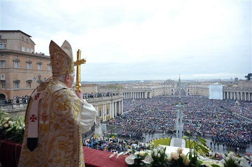 "Pope Benedict XVI addresses the faithful during the ""Urbi et Orbi"" (To the city and the World) message, at the end of the Easter Mass in St. Peter's square, at the Vatican, Sunday, April 4, 2010. (AP Photo/L'Osservatore Romano)"
