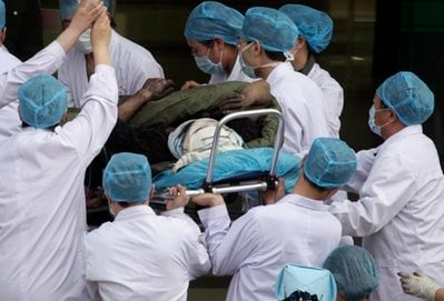 A coal miner rescued from the Wangjialing Coal Mine in Xiangning county is rushed into a hospital in Hejing town in north China's Shanxi province on Monday, April 5, 2010.