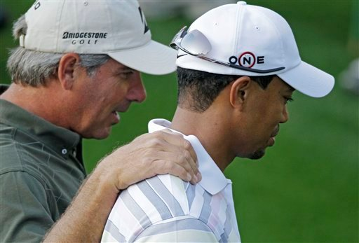Fred Couples, left, walks with Tiger Woods to the first green during a practice round for the Masters golf tournament in Augusta, Ga., Monday, April 5, 2010.  (AP Photo/Charlie Riedel)