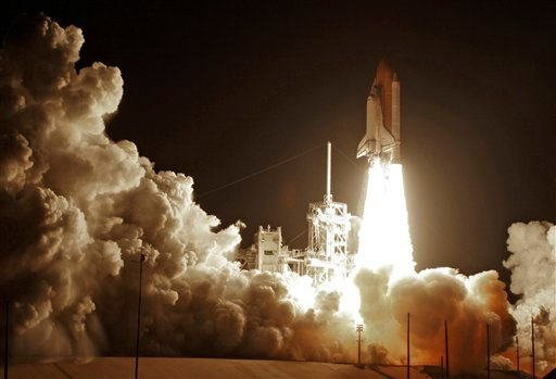 Space Shuttle Discovery lifts-off from the Kennedy Space Center at Cape Canaveral, Fla. Monday April 5, 2010. (AP Photo/John Raoux)