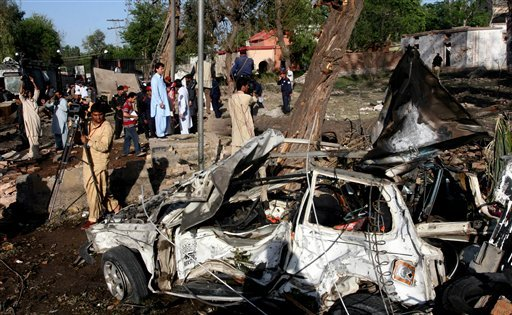 A view of destruction caused by a suicide bombing near the U.S. consulate in Peshawar, Pakistan on Monday, April 5, 2010.  (AP Photo/Mohammad Sajjad)