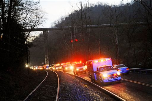 Emergency vehicles leave the entrance to Massey Energy's Upper Big Branch Coal Mine Monday, April 5, 2010 in Montcoal, W.Va. after an explosion at the underground coal mine. (AP Photo/Jeff Gentner)