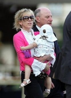 FILE - In this Aug. 6, 2009 file photo, Rielle Hunter holds her child as she is escorted from the Terry Sanford Federal Building and Courthouse in Raleigh, N.C. (AP Photo/Jim R. Bounds, file)