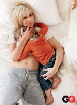 In this Feb. 3, 2010 photo provided by GQ, Rielle Hunter holds Frances Quinn, her 2-year-old daughter fathered by John Edwards, at her home in Charlotte, N.C.