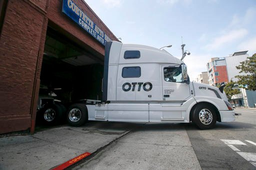 In this Aug. 18, 2016, file photo, one of Otto's self-driving, big-rig trucks leaves the garage for a test drive during a demonstration at the Otto headquarters in San Francisco.