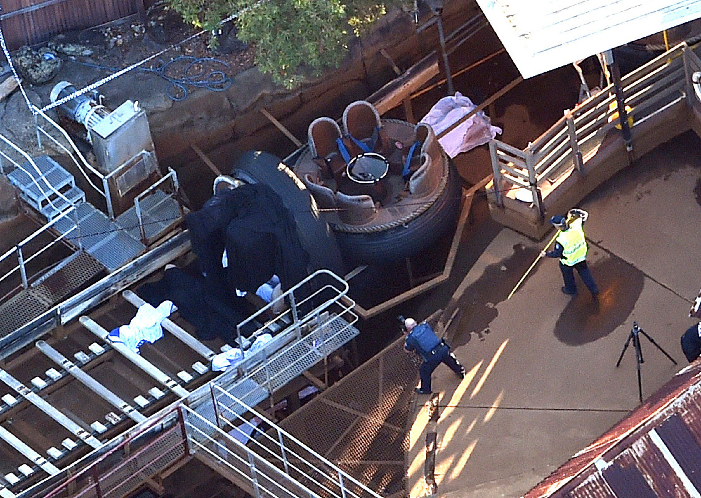 Queensland Emergency Services personnel are seen at the Thunder River Rapids ride at Dreamworld on the Gold Coast, Australia, Tuesday, Oct. 25, 2016. Four people died after a malfunction caused two people to be ejected from their raft, while two others we