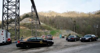 State troopers guard an entrance to Massey Energy Co.'s Upper Big Branch mine in Montcoal, W. Va. Wednesday, April 7, 2010. Twenty-five miners are known to be dead following an explosion at the mine Monday. (AP Photo/Ed Reinke)