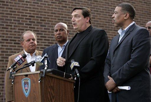 Trenton Police Capt. Joseph Jurniak, second from right, along with Mercer County Prosecutor Joe Bocchini, left, Trenton Mayor Doug Palmer, second from left, and Police Director, Irving Bradley.