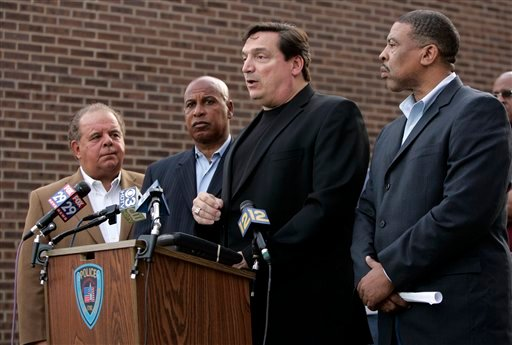 Trenton Police Capt. Joseph Jurniak, second from right, along with Mercer County Prosecutor Joe Bocchini, left, Trenton Mayor Doug Palmer, second from left, and Police Director, Irving Bradley.